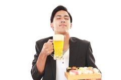 The man who eats sushi Royalty Free Stock Photography