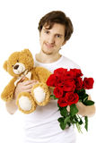 Man who gives bear and a bouquet of roses Royalty Free Stock Images