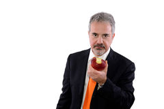Man who has bitten an apple. Man biting an apple on a white background royalty free stock photography