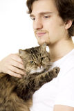 Man who keeps on hand fluffy cat Royalty Free Stock Images