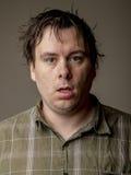 Man who looks like he just woke up Stock Image