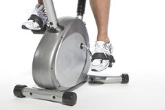 Man who pedal stationary bikes. Cyclette Stock Photo