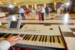 Man who playing on a electronic piano in restaurant. In natural light stock images