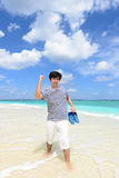 The man who relaxes on the beach. Stock Photos