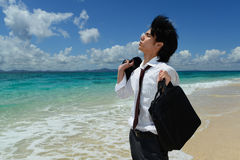 The man who relaxes on the beach. Royalty Free Stock Image
