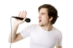 Man who sings in the microphone Royalty Free Stock Images