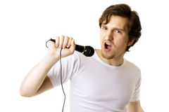 Man who sings in the microphone Stock Images