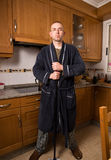 Man who takes the home chores with serious expression Stock Image