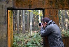 The man who takes a picture at a ruin in a mountain. The man who takes a picture at a ruin in a mountain in Japan royalty free stock photography