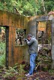 The man who takes a picture at a ruin in a mountain. The man who takes a picture at a ruin in a mountain in Japan stock images