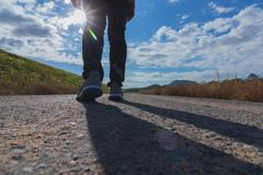 The man walks on the road. royalty free stock image