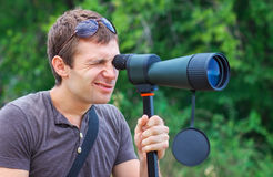 Man who is watching in spotting scope. Stock Image