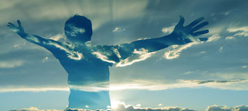 Man with Wide Open Arms. Double exposure image of man silhouette with wide open arms Stock Photography