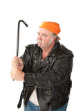 Man wielding a crowbar. Fat hoodlum with a mean face gripping a crow bar Royalty Free Stock Photo