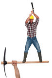 Man wielding pick-axe Stock Images