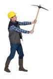 Man wielding pick-axe Royalty Free Stock Photos