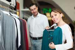 Man with wife choosing clothes Stock Photos