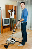 Man with wife doing housework Royalty Free Stock Photography