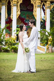 Man and wife get married in a Thai temple Royalty Free Stock Image