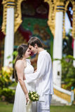 Man and wife get married in a Thai temple Royalty Free Stock Photography