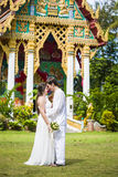 Man and wife get married in a Thai temple Stock Photography