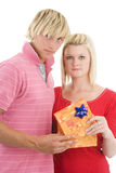 Man and wife with present. Royalty Free Stock Images