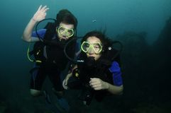Man and wife scuba diving Stock Images