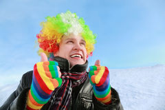 Man in wig of clown looks in sky Royalty Free Stock Photo