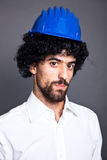 Man with Wig and Helmet Stock Image