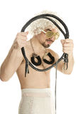 Man in wig with whip and handcuffs Royalty Free Stock Photos