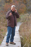 Man in wilderness 224. Man in wilderness on cell phone 224 Stock Photography