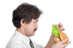 Man will get from hamburger sheet salad Royalty Free Stock Image