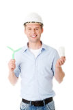 Man with a wind turbine and a light bulb. Stock Images