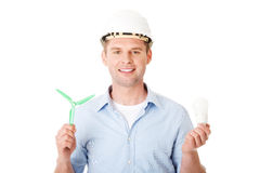 Man with a wind turbine and a light bulb. Royalty Free Stock Images