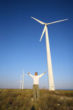 Man and wind turbines royalty free stock images
