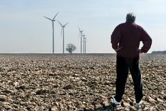 Man with wind turbines Royalty Free Stock Photography