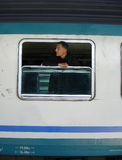 Man on the window. Asiatic man in train waiting for his travel to start Stock Photo