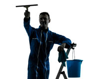 Man window cleaner silhouette worker silhouette. One caucasian man window cleaner worker silhouette in studio on white background Stock Images
