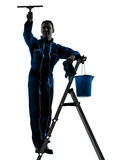 Man window cleaner silhouette worker silhouette. One caucasian man window cleaner  worker silhouette in studio on white background Royalty Free Stock Image