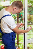 Man during window frame reparation Royalty Free Stock Image