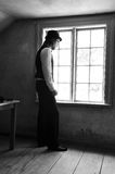 Man by the window Royalty Free Stock Photo