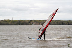 Man windsurfing on a board Stock Images
