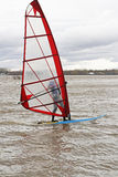 Man windsurfing on a board Stock Photo