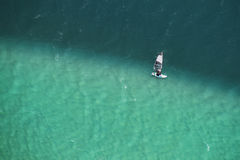 Man windsurfing in two colored sea aerial photo. Royalty Free Stock Image