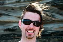 Man with windswept hair and sunglasses Royalty Free Stock Photos