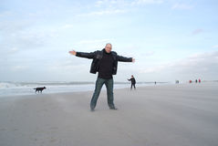 Man on windy and cold beach Stock Photos