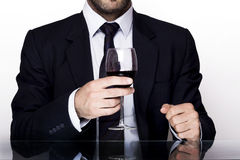 Man wine. Businessman holding a glass of wine Royalty Free Stock Photography