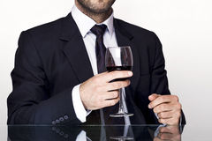 Man with wine. Businessman holding a glass of wine Royalty Free Stock Photography