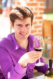 Man with wine in the cafe Royalty Free Stock Images