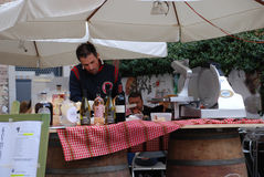 Man at Wine and Ham Stall Royalty Free Stock Photos